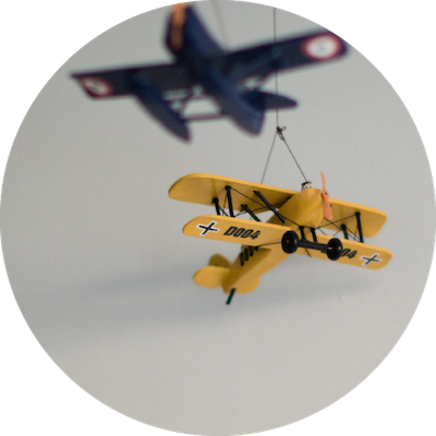 Two toy planes suspended from a ceiling
